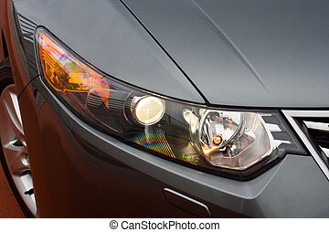 headlight of a car - headlight of a business sedan