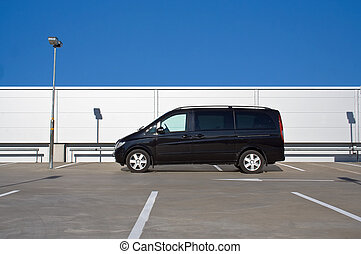 black minivan on a parking lot