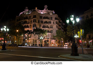 Casa Mila building at night in Barcelona, Spain