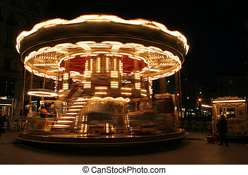 classical french carousel - merry-go-round twisting fast in...