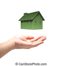 Green Eco house concept  with hand isolated on white background