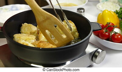 Food Preparation - Frying Chicken - Female frying chicken...