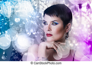glamorous stylish short haired woman with disco lights