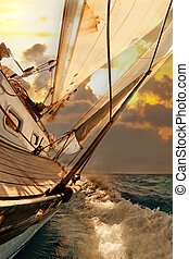 Sailboat crop during the regatta at sunset ocean