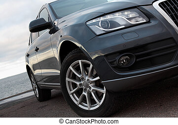 Headlight and front wheel - Modern SUV headlight and front...
