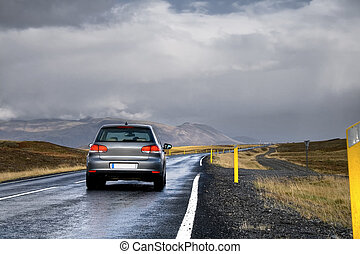 Car on a road in a countryside - A new car driving fast on a...