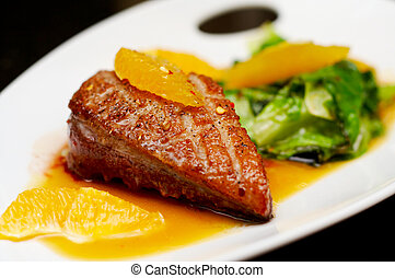 Roasted duck breast fillet with miso-orange sauce and fried...