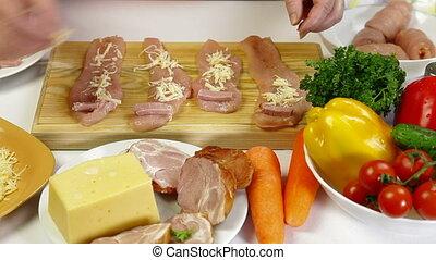Food Preparation - Rolls of Chicken - Women's hands cooking...