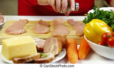 Food Preparation - Chicken Breast - Women's hands cooking...