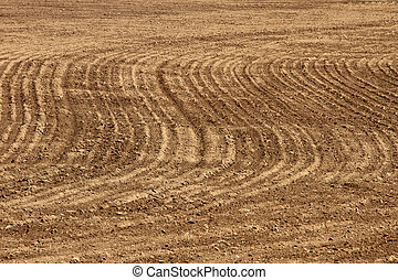 Agriculture background - plowed field - Plowed and...