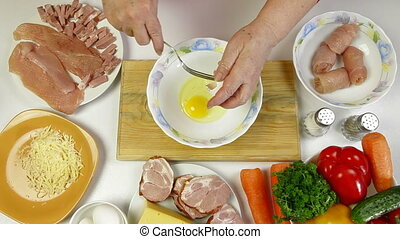 Food Preparation - Whisking Eggs - Womens hands cooking...