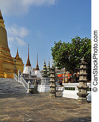 Classic gilded temple - stupa in the form of bell