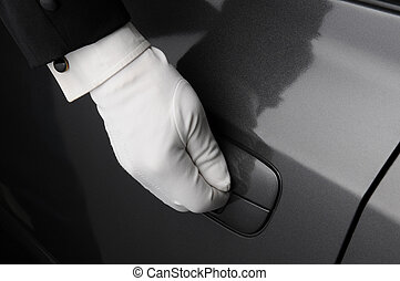 Doorman Opening Car Door - Closeup of a doormans hand on the...