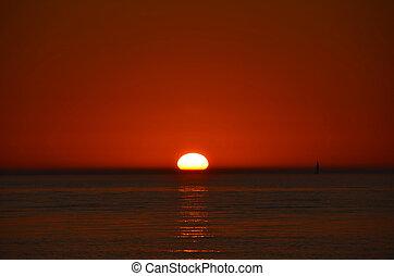 Lake Michigan Sunset - Sunset with sailboat on Lake...