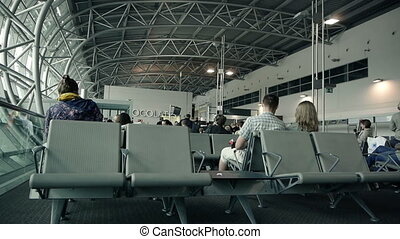 Airport Waiting Lounge - People waiting in airport lounge.