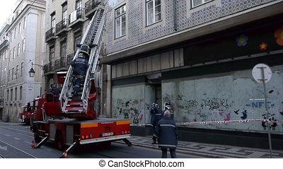 Firemen Climbing Ladder - Portuguese firemen climb ladder in...