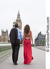 Rear view of romantic man and woman couple on Westminster Bridge with Big Ben in the background, London, England, Great Britain