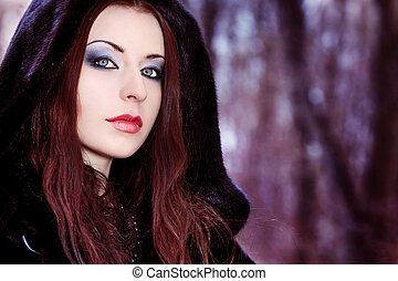 winter - Shot of a gothic woman in a winter park. Fashion.