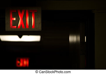exit sign in a corridor - picture of two exit sign in a...