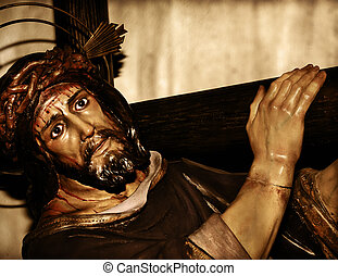 Jesus Christ carrying the holy cross - a figure of Jesus...