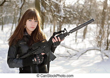 Beautiful armed girl in the forest