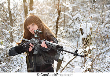 Brunette girl aiming a gun - Armed young brunette girl...