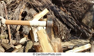 split firewoods slowmotion - axe being used to chop firewood