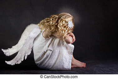 A fallen angel or child angel who is sad
