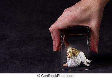 An angel trapped under a glass, a child angel or fallen...