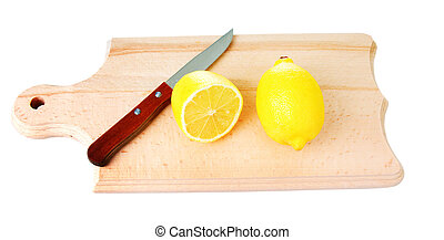 Cut lemon and knife on wooden plank - One whole lemon and...