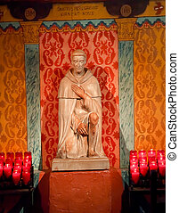 St. Peregrine's Stone Statue Shrine, Cancer Saint, Mission San Juan Capistrano Church California.  Father Junipero Serra founded the Mission in 1775 and church was destroyed in 1812 by earthquake.