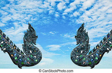 The Carving wood of naga isolated on blue sky background