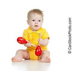 Baby  boy with musical toys. Isolated on white background