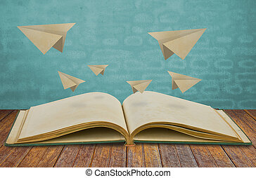 Magic book with paper plane