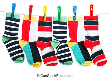The socks - Six striped socks hanging on the clothesline....