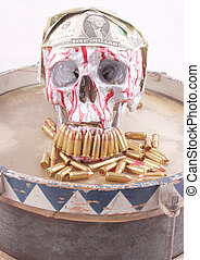 tin drum - A tin drum with a human skull with 1 US dollar...