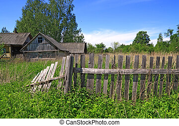 old fence near rural wooden building