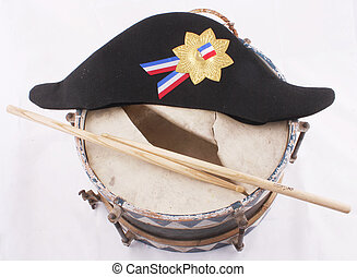 tin drum - A broken tin drum with a napoleon hat