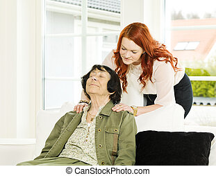 Massage situation - Young woman giving massage to her...