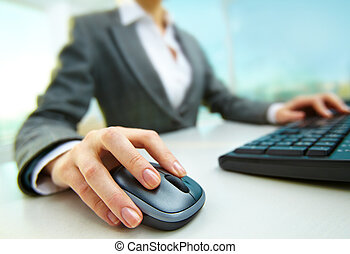 During work - Image of female hands pushing keys of a...