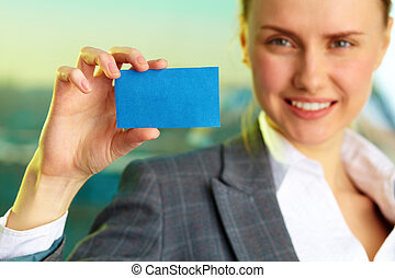Showing visiting card - Image of confident businesswoman...