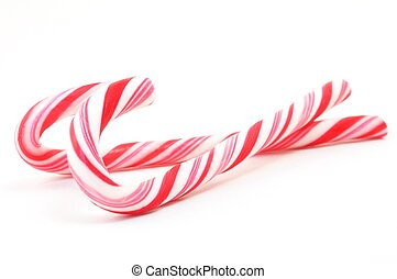 Candy Canes - Christimas candy canes isolated on a white...