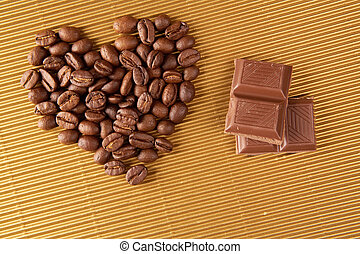 Heart and chocolate - Image of grained coffee heart and...