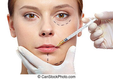 Botox therapy - Fresh woman with marks drawn on face during...