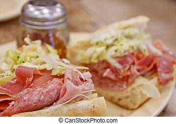 Italian Sub Sandwich - An italian sub sandwich dressed with...