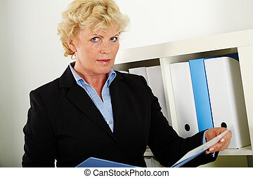 Mature businesswoman - Portrait of smiling middle aged...