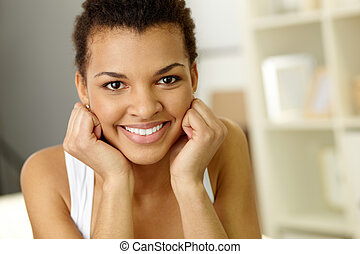 Cheerful girl - Image of young African girl looking at...