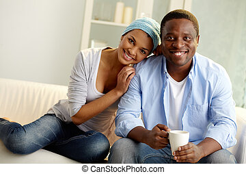 Togetherness - Image of young African couple looking at...