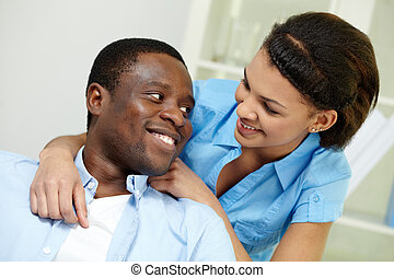 African couple - Image of young African couple looking at...