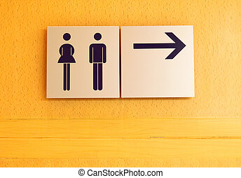Toilet sign and direction on wood wall